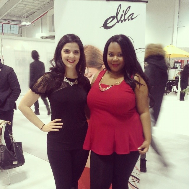Kim Caldwell and Asia Monet pose in front of the Elila booth at the Curve Expo 2014