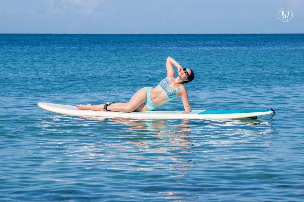 Kimmay on paddle board wearing Anita sports bra, Hurray Kimmay blog