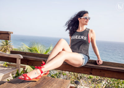 Kimmay wearing red shoes and queens shirt in Puerto Rico