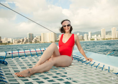 Kimmay on boat in Hawaii Mia Marcelle red swimsuit Invest In yourself