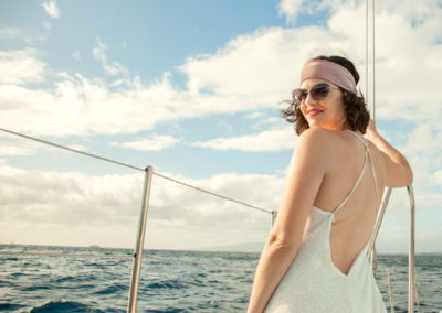 Kimmay on boat in Mia Marcelle dress back How to Invest In Yourself